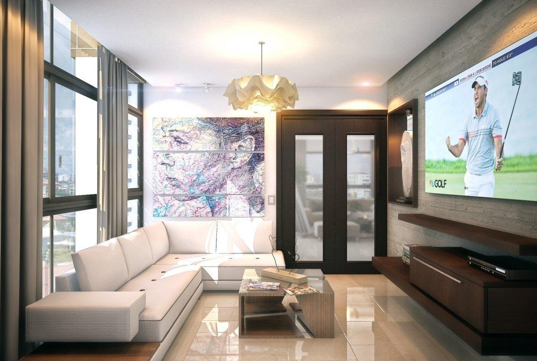 Torre Alinea - Ensanche Paraíso sala de estudio con muebles y TV plana empotrada en la pared, con muebles y puerta en madera y cristal, ventana en vidrio, cuadro y lámpara de techo